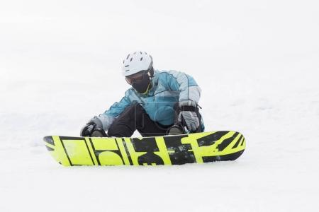 guy, snowboarder standing on a hill, high mountain