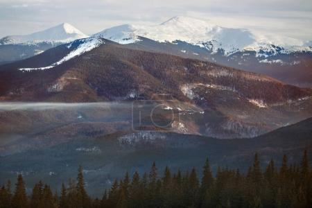 high mountains with snowy peaks at sunset