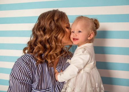 Photo for Mom and daughter are at home in the room, Mother's Day. - Royalty Free Image