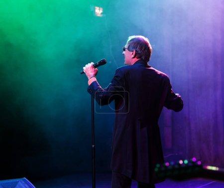 Photo for ODESSA, UKRAINE - Nov. 1, 2019: concert performance by Adriano Celentano. Soloist of the music group - Adolfo Sebastiani - famous singer, showman Celentano. Tribute Show Celentano. Italian pop legend - Royalty Free Image