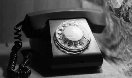 Photo for Landline old telephone, vintage background. Old disk telephone with the USSR Quality Mark of the last century - Royalty Free Image