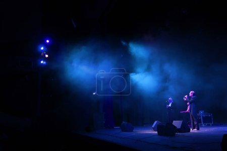 Photo for Stage lights. Background in show. Light spotlight in the dark. The interior of the theater scene is illuminated to the projector. Stage lights and stage smoke during the concert - Royalty Free Image
