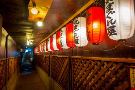 KYOTO, JAPAN - JULY 05, 2017: Beautiful paper lamps at night inside of a building in Gion DIstrict, Kyoto