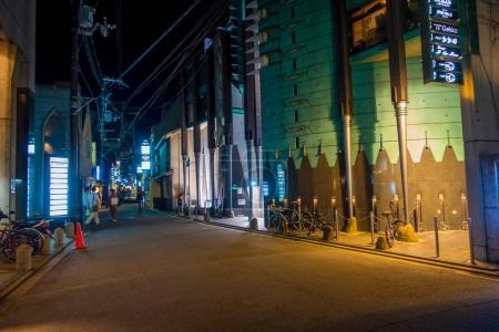 KYOTO, JAPAN - JULY 05, 2017: Night scene of tourists wondering around the narrow street of Gion DIstrict, Kyoto