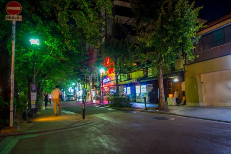 KYOTO, JAPAN - JULY 05, 2017: Unidentified people walking at night scene of tourists around the narrow street of Gion DIstrict, Kyoto