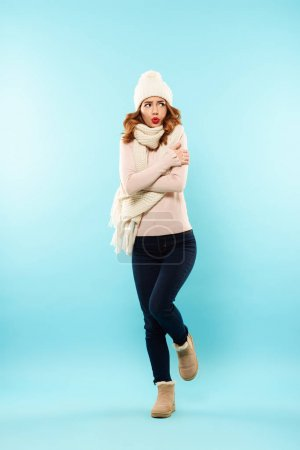Full length portrait of a frozen young girl
