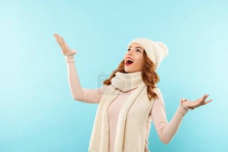 Portrait of a happy cheerful girl dressed in winter clothes