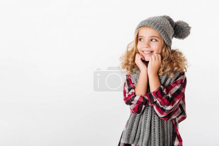 Portrait of a lovely little girl dressed in winter hat