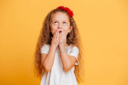 Shocked little girl child standing isolated