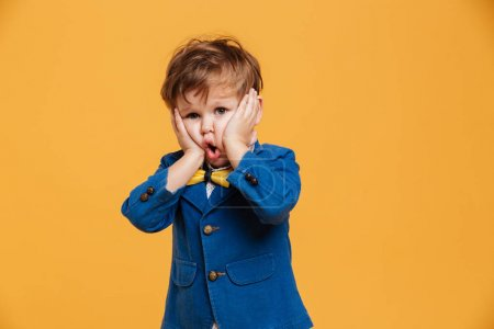 Shocked screaming boy child standing isolated