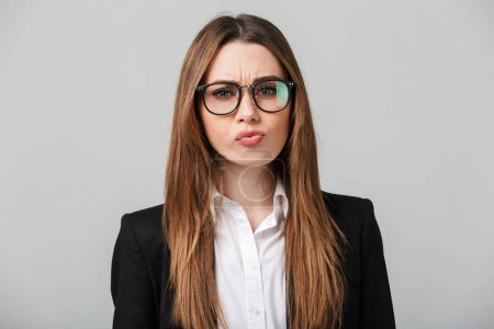Serious businesslady frown and looking camera isolated