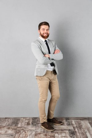Portrait of a satisfied businessman dressed in suit