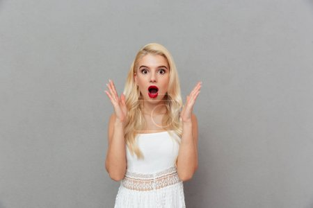 Portrait of a surprised girl standing and looking at camera