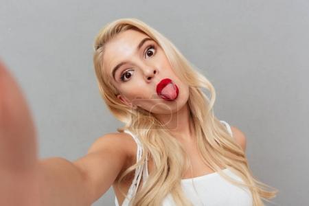 Portrait of a funny girl taking a selfie