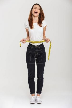 Full length portrait of an upset young woman