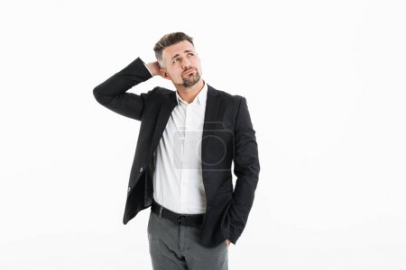 Portrait of man in office wearing jacket looking aside and touch