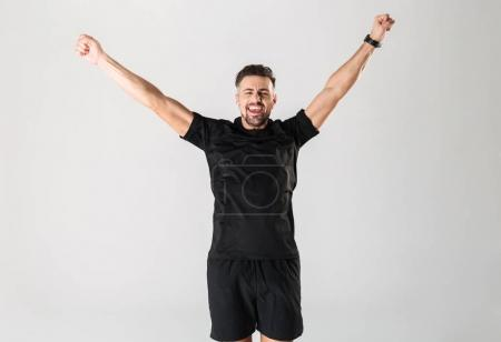 Portrait of a happy mature sportsman celebrating success