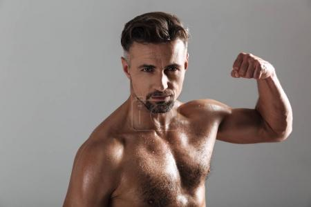 Close up portrait of a strong mature shirtless sportsman