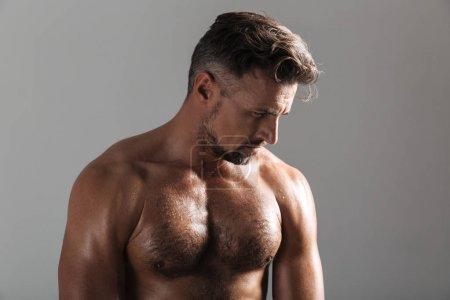 Close up portrait of a muscular mature shirtless sportsman