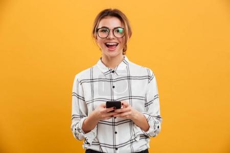 Portrait of beautiful woman in plaid shirt and eyeglasses posing