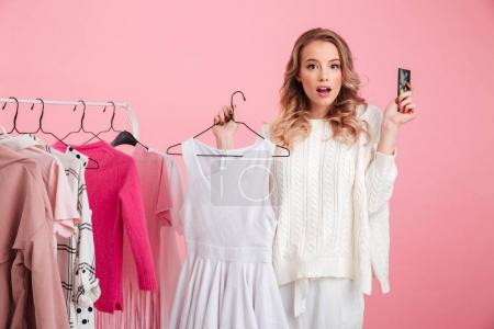 Amazing beautiful lady choosing clothes