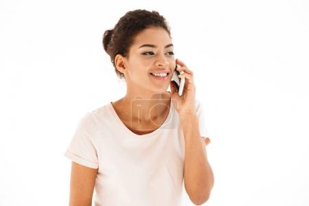 Image of mixed race woman in casual looking aside and talking on