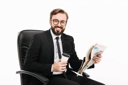 Portrait of happy man in office wearing suit and eyeglasses hold