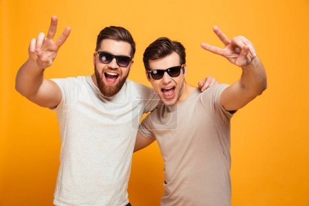 Portrait of a two happy young men in sunglasses