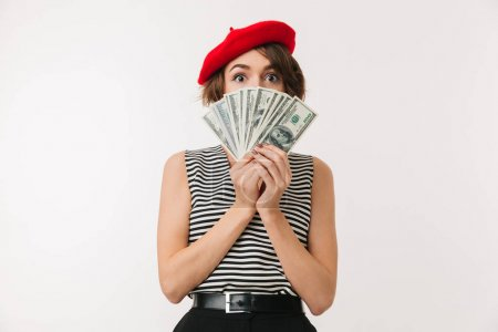 Image of rich woman having french style covering face with fan o