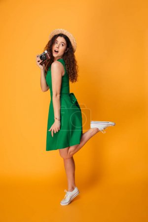 Full length portrait of a pretty curly haired girl