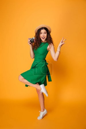 Full length portrait of a cheerful curly haired girl