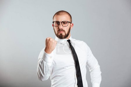 Photo of purposeful businessman in white shirt and eyeglasses ge