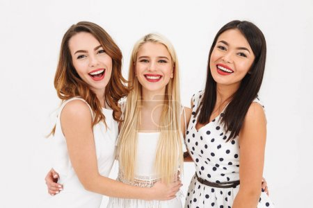 Portrait of three happy young girls smartly dressed