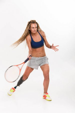 Young disabled sports woman tennis-player
