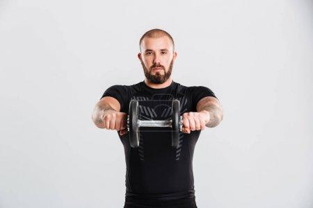 Portrait of strong sportive bodybuilder in black sportswear trai