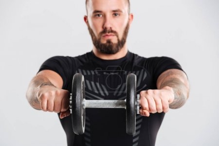 Portrait closeup of strong sportive bodybuilder in black sportsw
