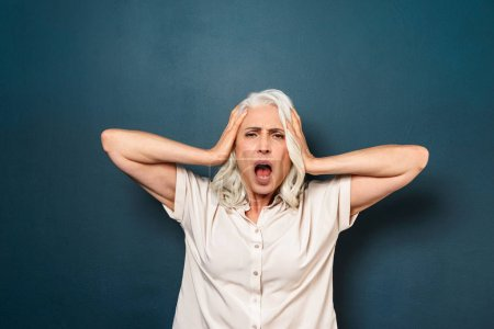 Mature old woman with headache