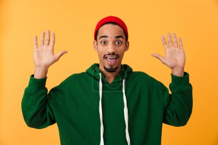 Portrait of a surprised young afro american man in hat