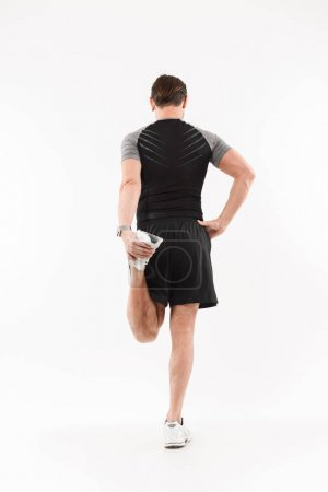 Back view full length portrait of a fit mature sportsman