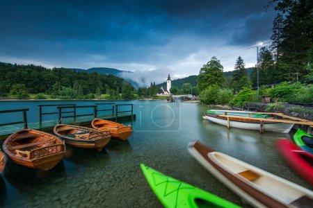 Colorful kayaks at lake Bohijn, Slovenia