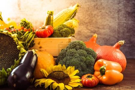 Wooden box with autumn market fresh crop vegetables