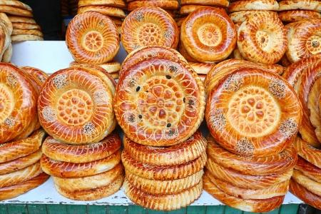 Photo for Flat cakes from tandoor on market counter in Bishkek, Kyrgyzstan - Royalty Free Image