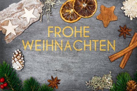 Christmas decoration on shale with merry christmas in german