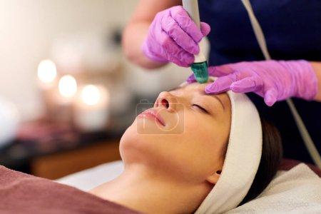 woman having microdermabrasion facial treatment