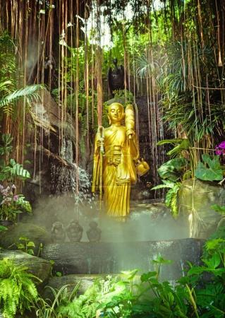 Golden Buddha on green jungle background