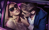 Nightlife - handsome man seducing a beautiful lady