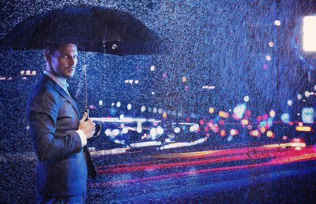 Conceptual portrait of a businessman looking at the nightlife