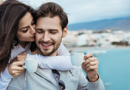 Romantic couple drinking a mornig cup of coffee