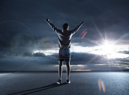 Fit guy looking at the dark sky