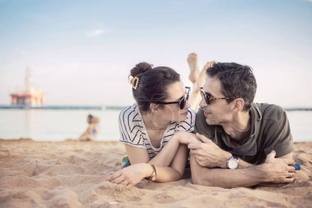 Romantic couple relaxing on a beach